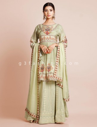 Designer sharara suit in pista green inflated with print