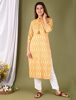 Designer sun yellow printed cotton casual wear kurti