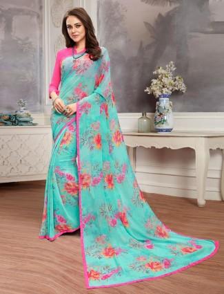 Effective aqua printed georgette saree for festive wear