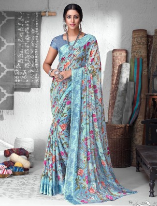 Effective blue printed chiffon satin saree for festive wear