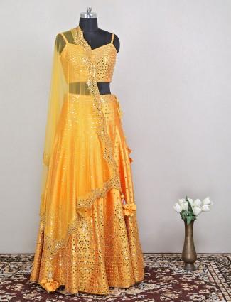 Elegant wedding style bright yellow hue lehenga in raw silk