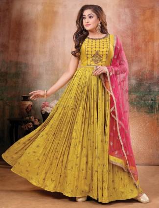 Elegant yellow raw silk anarkali suit for festive wear