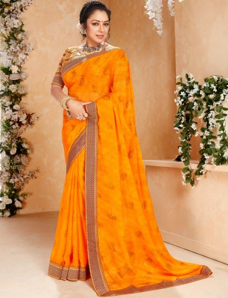 Excellent turmeric yellow printed georgette saree