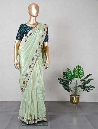 Exclusive green satin wedding wear saree