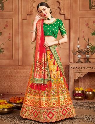Extravagant orange patola silk unstitched lehenga choli for wedding event