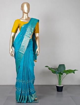Extravagant weddding wear blue silk saree