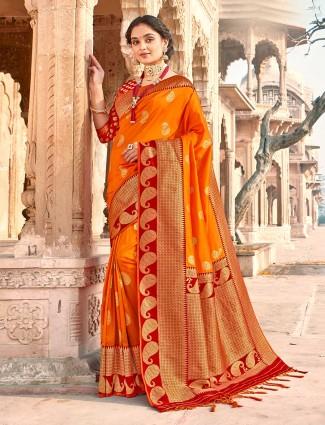 Fashionable orange banarasi silk saree for wedding session