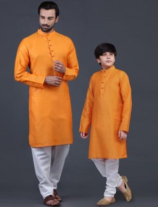 Father and son festive wear cotton kurta suit in orange