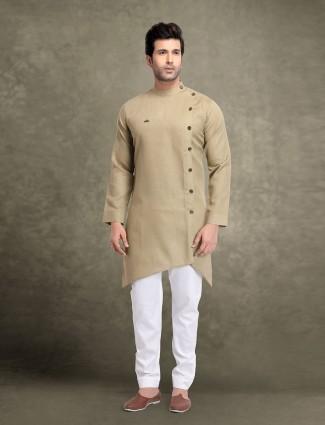 Festive wear beige cotton solid kurta suit