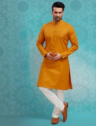 Festive wear printed mustard yellow stand collar cotton kurta suit