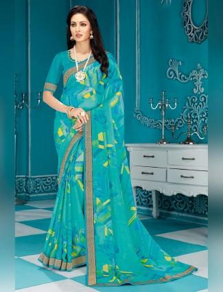 Festive wear saree in aqua printed in georgette