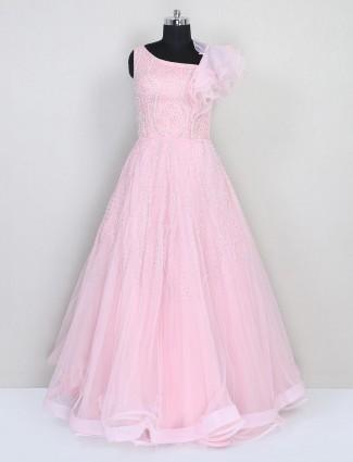 Floor-length pink net gown for wedding look