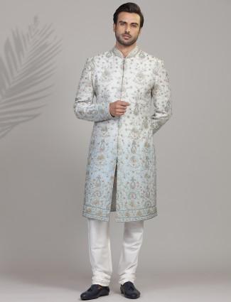 Fresh and stylish grey and blue shade silk sherwani for groom