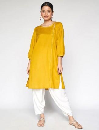 Global Desi Casual wear solid kurti for women in ochre yellow
