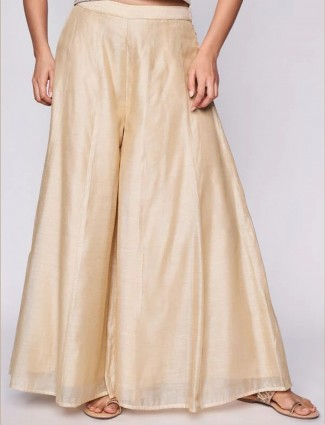Global Desi solid gold colored raw silk palazzo for women