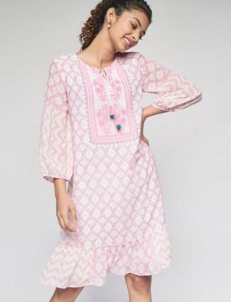 Global Desi Stuning baby pink printed kurti in cotton