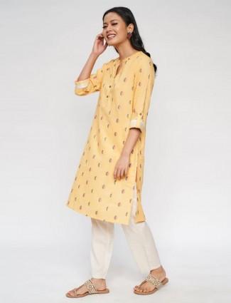 Global Desi yellow printed cotton kurti for casual look