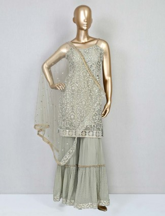 Green net sharara suit for wedding function