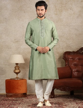 Green silk fabric kurta suit for festive