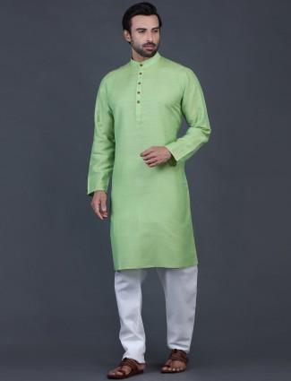 Green solid cotton kurta suit for festive