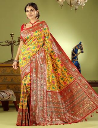 Honey yellow patola silk wedding event saree with ready made blouse