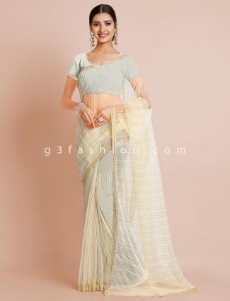 Latest designer cream tissue silk saree for wedding