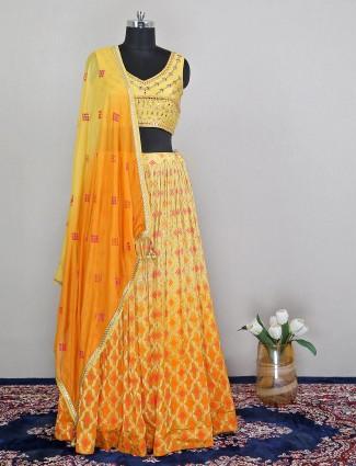 Lavish wedding wear yellow lehenga in raw silk