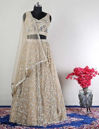 Light brown reception wear lehenga in net