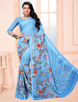 Lovely blue printed chiffon satin saree for festive wear