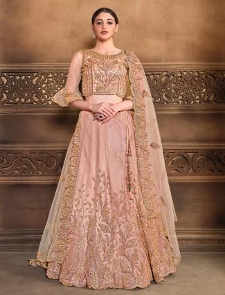 Lovely wedding wear heavy semi stitched lehenga choli in peach colored