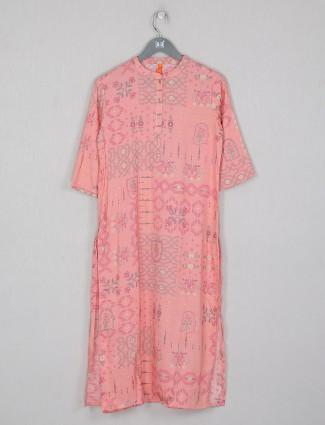 Luxuriant peach cotton casaul wear printed kurti