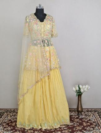Luxurious wedding style pink  and yellow shade lehenga with odhani