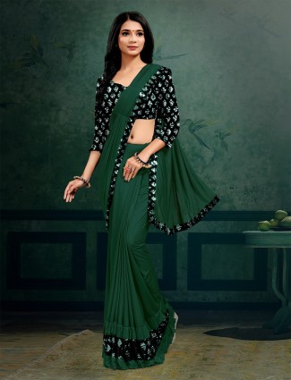 Lycra party saree in bottle green hue