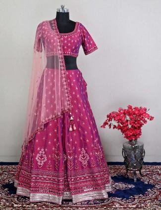 Magenta hue wedding lehenga choli in raw silk