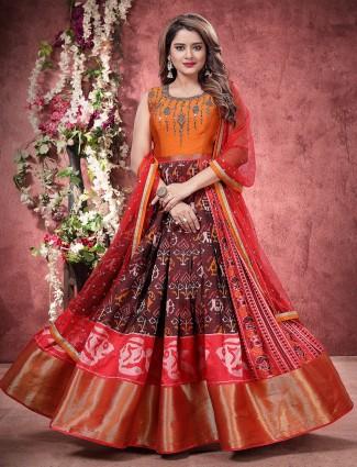 Maroon color patola silk floor length anarkali salwar suit