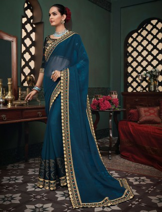 Marvellous navy blue georgette saree for festive occasions
