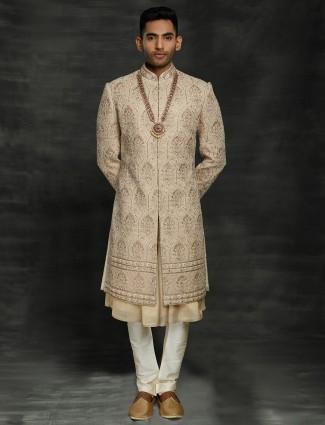 Marvelous gold silk groom double layer sherwani churidar set