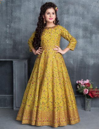 Mustard yellow color wedding wear silk gown
