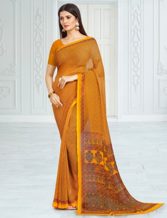 Mustard yellow printed georgette festive wear saree