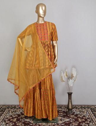 Mustard yellow printed raw silk sharara suit for wedding