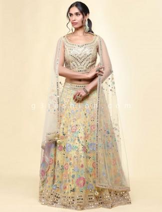 Net yellow wedding wear lehenga choli