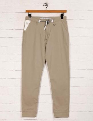 Nostrum solid beige cotton slim fit trouser