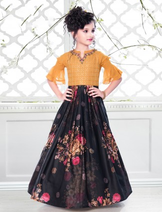 Ochre yellow and black shade printed gown for girl