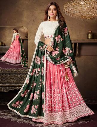 off white and coral pink georgette wedding wear lehenga choli