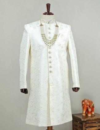 Off white colored silk sherwani for wedding