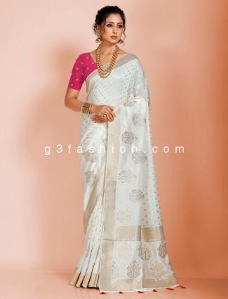 Off white dola silk saree with nice tassels on pallu