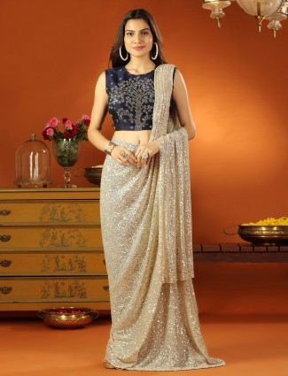 Beige ready to wear saree with readymade blouse with sequins details