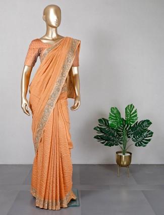 Orange color silk saree for women