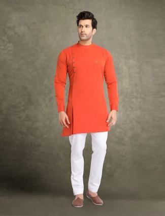 Orange half buttoned placket cotton kurta suit