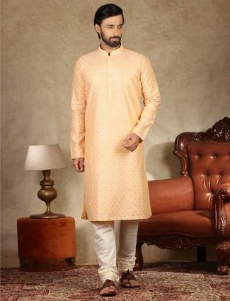 Orange kurta suit in linen with chikan thread work